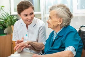 a woman receives personal senior care at rittenhouse village
