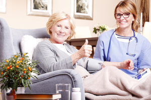 a woman gives thumbs up for her senior respite care