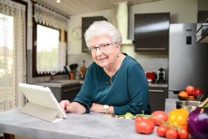 a senior is happy with her senior living amenities