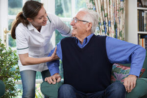 a man is happy to be receiving senior personal care