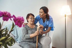 a woman is happy to receive respite care for seniors
